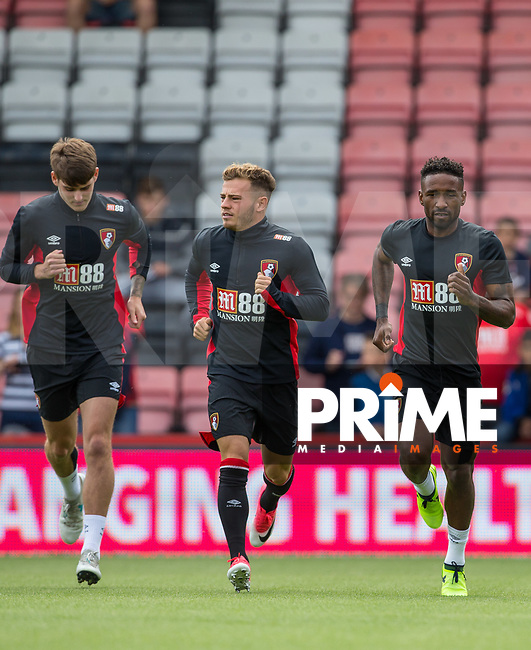 (r-l) Jermain Defoe, Ryan Fraser & Connor Mahoney of AFC Bournemouth warm up during the Friendly match between Bournemouth and Valencia  at the Goldsands Stadium, Bournemouth, England on 30 July 2017. Photo by Andy Rowland.