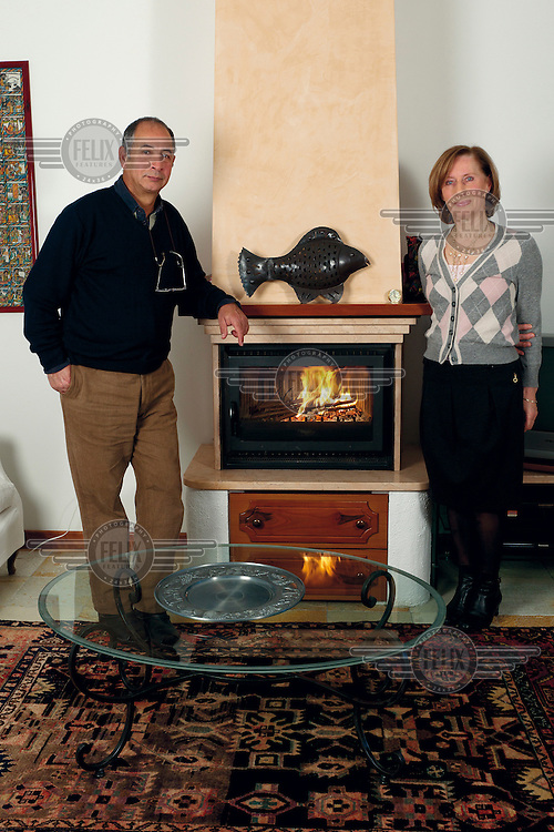 A retired couple in the living room of their new build semi-detached house in the small provincial town of Funo.
