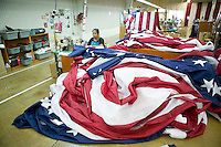 21 June 2005 - Oaks, PA - Virbala Patel assembles parts of American flags at the Annin & Co. flag manufacturing plant in Oaks, PA. Photo Credit: David Brabyn.