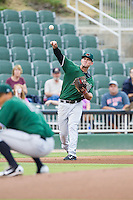 Augusta GreenJackets third baseman Sam Mende (15) makes a throw to first base against the Kannapolis Intimidators at CMC-NorthEast Stadium on July 31, 2014 in Kannapolis, North Carolina.  The Intimidators defeated the GreenJackets 4-3.  (Brian Westerholt/Four Seam Images)