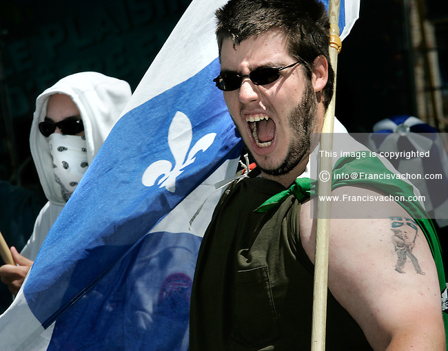 """Quebec City, July 1, 2007 ? Protesters take part into the annual MLNQ (Mouvement de liberation National du Québec) Canada Day protest in front of the Quebec City hall July 1, 2007. Each year, the MLNQ gather a couple of dozens of hard line separatists to protest the """"Canadian colonialism demonstration of Canada Day""""."""