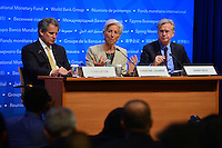 Washington, DC - April 14, 2016: Christine Lagarde (c), Managing Director of the International Monetary Fund, prepares to speak to members of the media during a press availability at the IMF headquarters in the District of Columbia, April 14, 2016. To her left is David Lipton, IMF First Deputy Managing Director and Gerry Rice, IMF Communications Director. (Photo by Don Baxter/Media Images International)