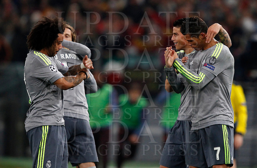 Calcio, andata degli ottavi di finale di Champions League: Roma vs Real Madrid. Roma, stadio Olimpico, 17 febbraio 2016.<br /> Real Madrid's Cristiano Ronaldo, right, celebrates with teammates after scoring during the first leg round of 16 Champions League football match between Roma and Real Madrid, at Rome's Olympic stadium, 17 February 2016.<br /> UPDATE IMAGES PRESS/Riccardo De Luca