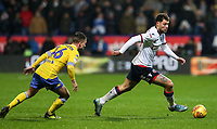 Bolton Wanderers' Yanic Wildschut breaks away from  Leeds United's Jamie Shackleton<br /> <br /> Photographer Andrew Kearns/CameraSport<br /> <br /> The EFL Sky Bet Championship - Bolton Wanderers v Leeds United - Saturday 15th December 2018 - University of Bolton Stadium - Bolton<br /> <br /> World Copyright &copy; 2018 CameraSport. All rights reserved. 43 Linden Ave. Countesthorpe. Leicester. England. LE8 5PG - Tel: +44 (0) 116 277 4147 - admin@camerasport.com - www.camerasport.com
