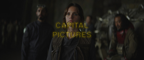 Rogue One: A Star Wars Story (2016)<br /> Bodhi Rook (Riz Ahmed), Jyn Erso (Felicity Jones) and Baze Malbus (Jiang Wen).<br /> *Filmstill - Editorial Use Only*<br /> CAP/KFS<br /> Image supplied by Capital Pictures