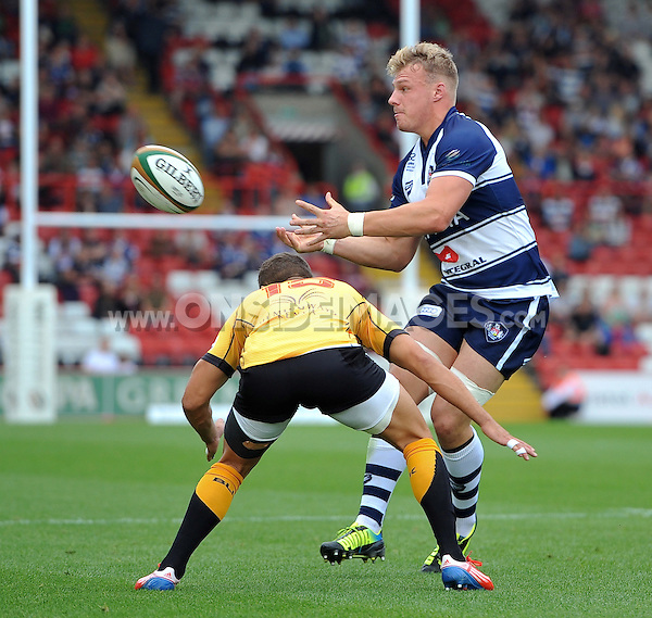 Mitch Eadie passes the ball. Greene King IPA Championship match, between Bristol Rugby and Cornish Pirates on September 21, 2014 at Ashton Gate in Bristol, England. Photo by: Patrick Khachfe / JMP