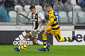 2nd February 2019, Allianz Stadium, Turin, Italy; Serie A football, Juventus versus Parma; Joao Cancelo of Juventus is challenged by Riccardo Gagliolo of Parma