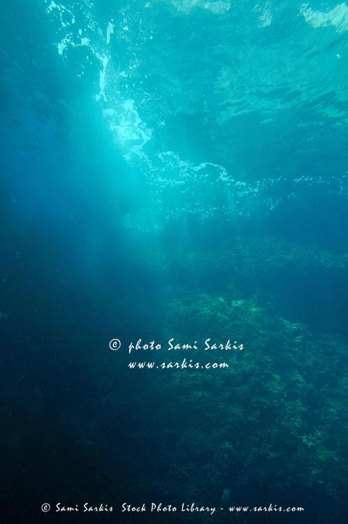 Light penetrating water surface, underwater view, Mediterranean sea