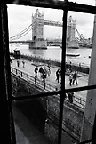 ENGLAND, London, the iconic Tower Bridge is a bascule and suspension bridge over the River Thames (B&W)