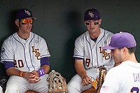 LSU Tigers third baseman Conner Hale (20) and shortstop Alex Bregman (8) relax in the dugout before their NCAA College World Series game against the TCU Horned Frogs on June 14, 2015 at TD Ameritrade Park in Omaha, Nebraska. TCU defeated LSU 10-3. (Andrew Woolley/Four Seam Images)