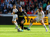 Saturday, 20 October 2012<br /> Pictured: Angel Rangel of Swansea (R) Marking Shaun Maloney (L) of Wigan<br /> Re: Barclays Premier League, Swansea City FC v Wigan Athletic at the Liberty Stadium, south Wales.