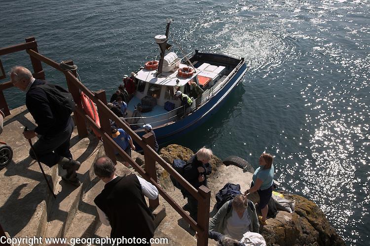 Tourist boat arrival Skomer Island, Pembrokeshire, Wales