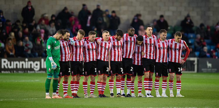Lincoln City players during a minutes silence as mark of respect to Grace Millane, a former University of Lincoln pupil<br /> <br /> Photographer Chris Vaughan/CameraSport<br /> <br /> The EFL Sky Bet League Two - Saturday 15th December 2018 - Lincoln City v Morecambe - Sincil Bank - Lincoln<br /> <br /> World Copyright © 2018 CameraSport. All rights reserved. 43 Linden Ave. Countesthorpe. Leicester. England. LE8 5PG - Tel: +44 (0) 116 277 4147 - admin@camerasport.com - www.camerasport.com