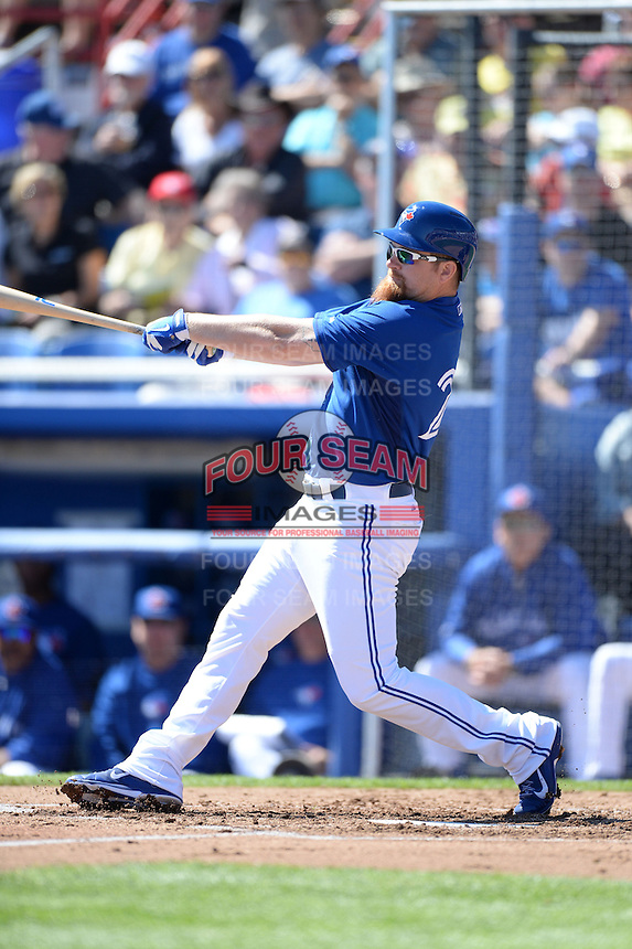 Toronto Blue Jays first baseman Adam Lind (26) during a spring training game against the Pittsburgh Pirates on February 28, 2014 at Florida Auto Exchange Stadium in Dunedin, Florida.  Toronto defeated Pittsburgh 4-2.  (Mike Janes/Four Seam Images)