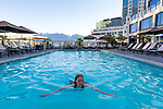 The rooftop pool of the Fairmont Waterfront Vancouver in downtown Vancouver, British Columbia, Canada with views of the mountains.