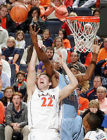 Jan. 8, 2011; Charlottesville, VA, USA;  North Carolina Tar Heels forward Justin Knox (25) reaches for the rebound with Virginia Cavaliers forward Will Sherrill (22) during the game at the John Paul Jones Arena. North Carolina won 62-56. Mandatory Credit: Andrew Shurtleff