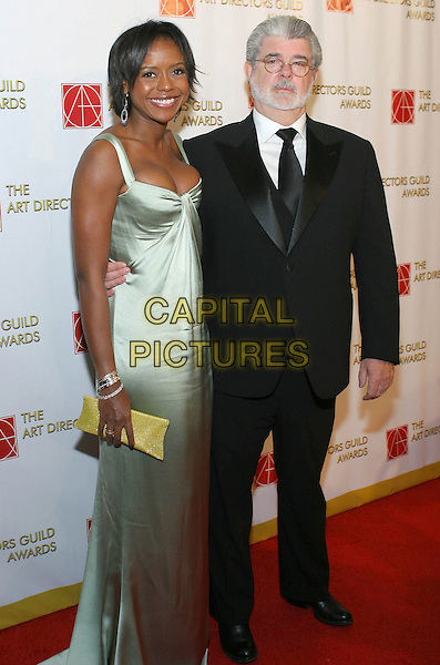 MELLODY HOBSON & GEORGE LUCAS .13th Annual Art Directors Guild Awards For Excellence In Production Design held at The Beverly Hilton Hotel, Beverly Hills, CA, USA, 14th February 2009..full length black suit tie green silk satin long maxi dress .CAP/ADM/TC.©T. Conrad//Admedia/Capital Pictures