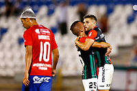 SANTIAGO DE CHILE - CHILE: 06-02-2019: Julián Fernández, jugador de Palestino (CHL), celebra con su compañero Agustín Arias el gol anotado a Deportivo Independiente Medellín (COL), durante partido de la Segunda fase, llave 4, entre Club Deportivo Palestino (CHL) y Deportivo Independiente Medellín (COL), por la Copa Conmebol Libertadores 2019 en el estadio San Carlos de Apoquindio, de la ciudad de Santiago de Chile. / Julian Fernandez, player of Club Deportivo Palestino (CHL), celebrates with his teammate Agustín Arias the goal scored against Deportivo Independiente Medellin (COL), during a match between Club Deportivo Palestino (CHL) and Deportivo Independiente Medellin of the second phase, key 4, for Copa Conmebol Libertadores 2019 at the San Carlos de Apoquindio Stadium, in the city of Santiago de Chile. Photos: VizzorImage / Javier Valdes Larrondo / Cont. / Xpress Media