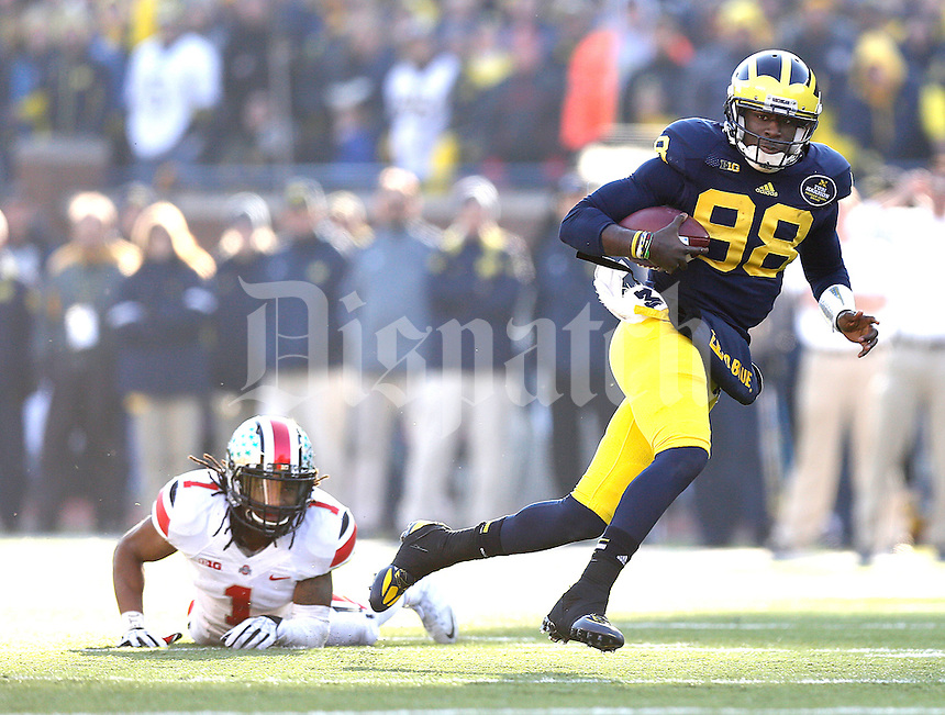 Michigan Wolverines quarterback Devin Gardner (98) gets by*Ohio State Buckeyes cornerback Bradley Roby (1)*** for a second half gain at Michigan Stadium in Ann Arbor, Michigan on November 30, 2013.  (Chris Russell/Dispatch Photo)