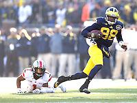 Michigan Wolverines quarterback Devin Gardner (98) gets by*Ohio State Buckeyes cornerback Bradley Roby (1)*** for a second half gain at Michigan Stadium in Ann Arbor, Michigan on November 30, 2013.  (Chris Russell/Dispatch Photo)