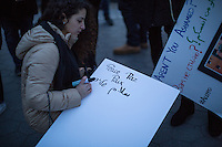 NEW YORK,NY December 16,2016: A woman writes a sign during a vigil to protest against the Syrian government and the killing of innocent people in Washington Square Park, in New York City, December  16,2016. Photo by VIEWpress/Maite H. Mateo