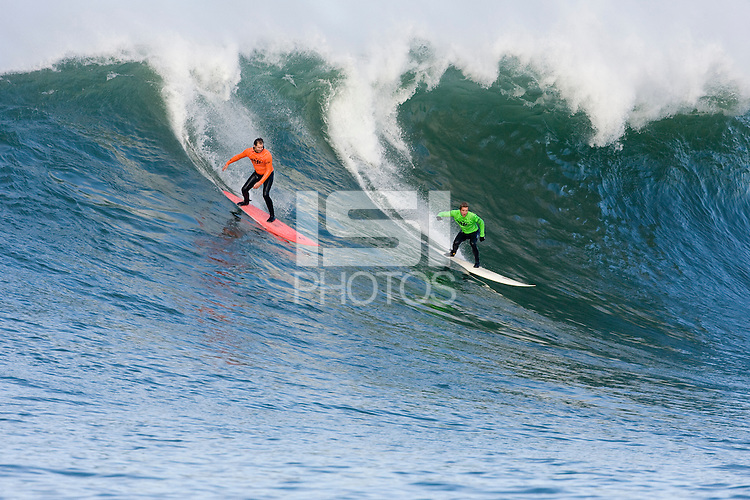 Jamie Sterling and Evan Slater shred a wave at  Mavericks Surf Contest 2008.  Half Moon Bay, Ca.  January 12, 2008.