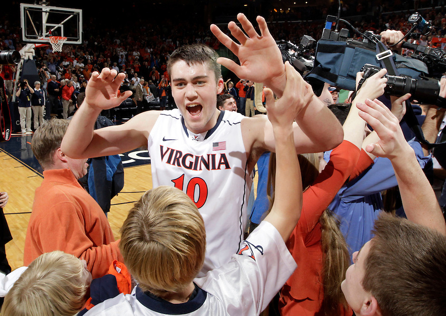 Virginia forward/center Mike Tobey (10) celebrates with fans after defeating Syracuse 75-56 in an NCAA basketball game Saturday March 1, 2014 in Charlottesville, VA. Photo/Andrew Shurtleff