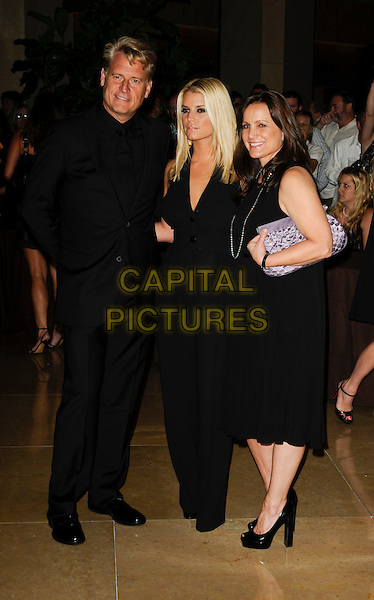 JOE SIMPSON, JESSICA SIMPSON & TINA SIMPSON.arriving at Operation Smile at the Beverly Hilton Hotel in Beverly Hills, California, USA, October 2nd 2009..full length halterneck black buttons catsuit jumpsuit dress suit mother father parents dad mom mum daughter family married husband wife shoes purple clutch bag .CAP/ROT.©Lee Roth/Capital Pictures.