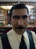 Portrait of waiter at the Cantina bar Oxford in the Tabacalera area of Mexico City. Stop for a quick beer during a night bike ride with Adrian Mealand and Michael Smith, Thursday April 12, 2007