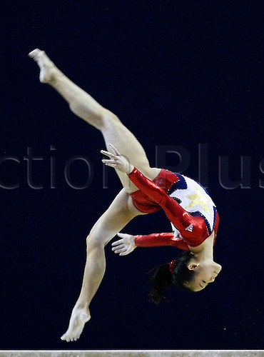 Gymnast Ivana Hong from the USA performs in the women´s beam final in the Artistic World Gymnastics Championships at the O2 Arena in London, Britain, 18 October 2009. The 41st Artistic World Gymnastics Championships are taking place in the English capital from the 13th to the 18th of October 2009.  Photo by Felipe Trueba/Actionplus.