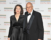 Washington, DC - December 5, 2009 -- Carl Reiner, right, and Ms. Annie Reiner, left, arrive for the formal Artist's Dinner at the United States Department of State in Washington, D.C. on Saturday, December 5, 2009..Credit: Ron Sachs / CNP.(RESTRICTION: NO New York or New Jersey Newspapers or newspapers within a 75 mile radius of New York City)