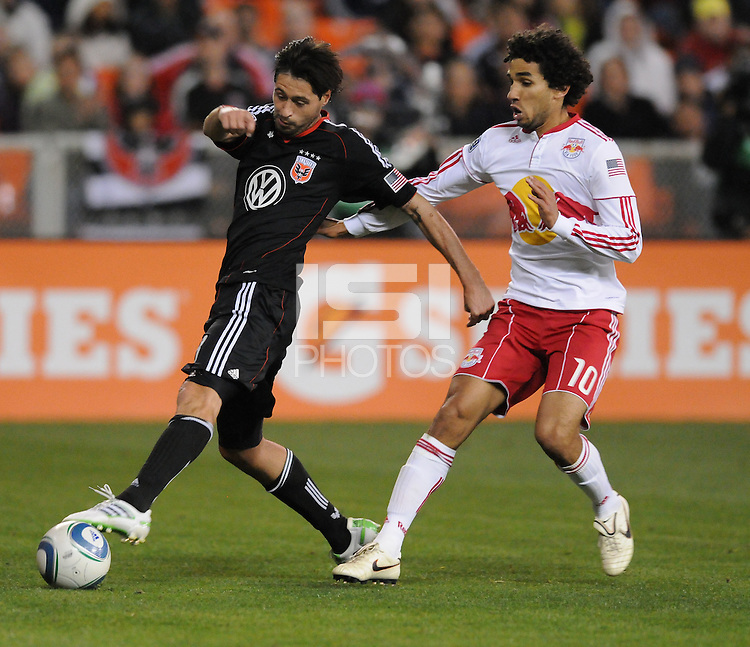DC United midfielder Branko Boskovic (8) shields the ball against New York Red Bulls midfielder Mehdi Ballouchy (10)  The New York Red Bulls defeated DC United 4-0, at RFK Stadium, Thursday April 21, 2011.
