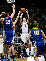 David Kravish of California shoots the ball during the game against UCSB Gauchos at Haas Pavilion in Berkeley, California on December 19th, 2011.   California defeated UC Santa Barbara, 7-50.