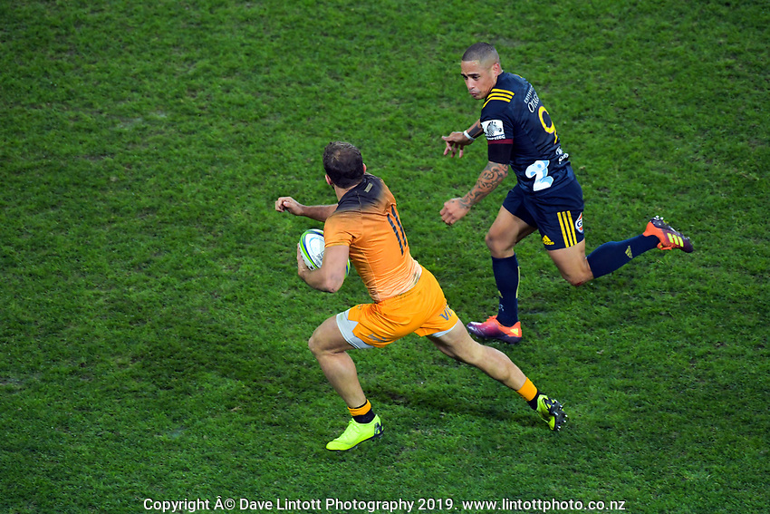 Ramiro Moyano beats Aaron Smith to score during the Super Rugby match between the Highlanders and Jaguares at Forsyth Barr Stadium in Dunedin, New Zealand on Saturday, 11 May 2019. Photo: Dave Lintott / lintottphoto.co.nz