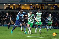 Ryan Dickson of Yeovil Town holds off Adebayo Akinfenwa of Wycombe Wanderers during the Sky Bet League 2 match between Wycombe Wanderers and Yeovil Town at Adams Park, High Wycombe, England on 14 January 2017. Photo by Andy Rowland / PRiME Media Images.