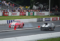 Jun. 1, 2012; Englishtown, NJ, USA: NHRA pro mod driver Donald Martin (right) races alongside Don Walsh during qualifying for the Supernationals at Raceway Park. Mandatory Credit: Mark J. Rebilas-