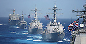 Pacific Ocean - June 18, 2006 -- USS Cowpens (CG 63) (foreground) is followed by USS Lassen (DDG 82), USS John S. McCain (DDG 56), USS Vandegrift (FFG 48) and USNS Tippecanoe (T-AO 199) during a photo exercise to kick off Exercise Valiant Shield 2006.  The Kitty Hawk Carrier Strike Group is currently participating in Valiant Shield 2006, the largest joint exercise in recent exercise Valiant Shield.  Held in the Guam operating area June 19-23, the exercise involves 28 Naval vessels including three carrier strike groups.  Nearly 300 aircraft and approximately 22,000 service members from the Navy, Air Force, Marine Corps, and Coast Guard are also participating in the exercise.<br /> Credit: U.S. Navy via CNP
