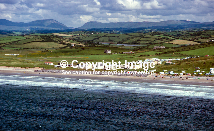 Aerial photograph, Rossnowlagh, Ballyshannon, Co Donegal, Rep of Ireland. In the distance is Barnesmore Gap. 19790160a..Copyright Image from Victor Patterson, 54 Dorchester Park, Belfast, UK, BT9 6RJ..Tel: +44 28 9066 1296.Mob: +44 7802 353836.Voicemail +44 20 8816 7153.Skype: victorpattersonbelfast.Email: victorpatterson@me.com.Email: victorpatterson@ireland.com (back-up)..IMPORTANT: If you wish to use this image or any other of my images please go to www.victorpatterson.com and click on the Terms & Conditions. Then contact me by email or phone with the reference number(s) of the image(s) concerned.