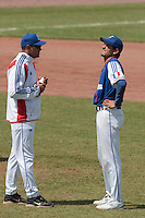 30 july 2010: Starting pitcher Samuel Meurant, in front of Team manager Sylvain Virey, is in pain after being hit in the arm by a ball during Sweden 3-2 win over France, in day 6 of the 2010 European Championship Seniors, at TV Cannstatt ballpark, in Stuttgart, Germany.