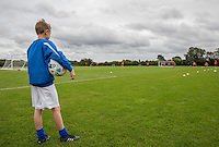 Taylor Hunt watches the team train as Ballboy Taylor Hunt  at Wycombe Wanderers Training Ground, High Wycombe, England on 25 August 2015. Photo by Andy Rowland.