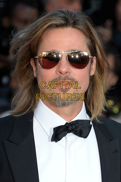 Brad Pitt.'Killing them Softly' premiere arrivals at the 65th  Cannes Film Festival, France 22nd May 2012.headshot portrait black tuxedo white shirt bow tie sunglasses shades goatee facial hair  .CAP/PL.©Phil Loftus/Capital Pictures.