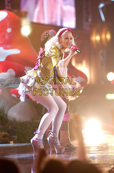 GWEN STEFANI.Brit Awards 2005.Earls Court 2, London, SW5.February 9th, 2005.full length, stage, concert live gig music pink lace up platform shoes layers ruffles singing.www.capitalpictures.com.sales@capitalpictures.com.©Capital Pictures