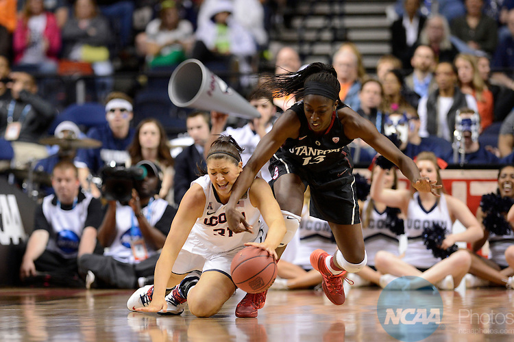 06 Apr 2014:  Stanford University forward Chiney Ogwumike (13) and Stefanie Dolson (31) of the University of Connecticut dive for a loose ball during the 2014 Division I Women's Final Four in Nashville, TN. Connecticut defeated Stanford 75-56 to move on to the National Championship.  Jamie Schwaberow/NCAA Photos