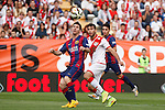 Rayo Vallecano´s Insua and Barcelona´s Leo Messi (L) during La Liga match between Rayo Vallecano and Barcelona at Vallecas stadium in Madrid, Spain. October 04, 2014. (ALTERPHOTOS/Victor Blanco)