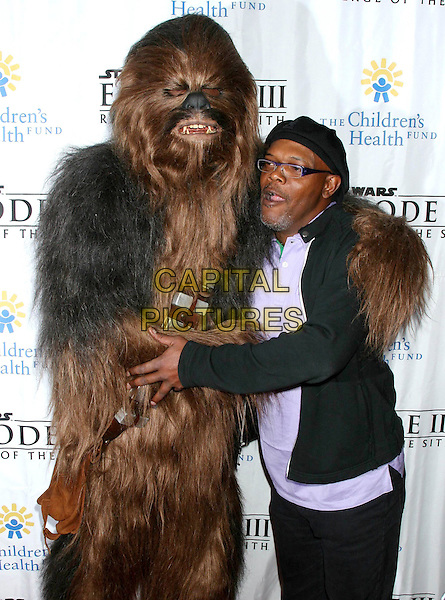 "CHEWBACCA & SAMUEL L. JACKSON.""Star Wars: Episode III: Revenge Of The Sith"" New York City Benefit Premiere - Inside Arrivals .Ziegfeld Theater, New York City, USA, May 12th 2005..half length funny in costume  hugging.Ref: IW.www.capitalpictures.com.sales@capitalpictures.com.©Ian Wilson/Capital Pictures."