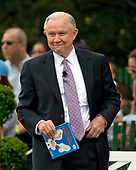 "United States Attorney General Jeff Sessions as he finishes reading ""It's Not Easy Being a Bunny"" to a group of children during the annual Easter Egg Roll on the South Lawn of the White House in Washington, DC following the arrival of US President Donald J. Trump and first lady Melania Trump on Monday, April 17, 2017.<br /> Credit: Ron Sachs / CNP"