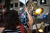 Berlin, Eine Besucherin fotografiert beim DMY International Design Festival, am Freitag (07.06.13) in ehemaligen Flughafen Tegel. Festival findet von Mittwoch (05.06.13) bis Sonntag (09.06.13) statt. Foto: Maja Hitij/CommonLens