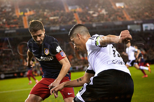 06.03.2016. Mestalla Stadium, Valencia, Spain. La Liga match between Valencia versus Atletico Madrid. Midfielder Enzo Perez of Valencia CF (R) is challenged by Midfielder Gabi of Atletico Madrid