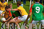 Ronan Murphy (Mid-Kerry) in action with Paudie Galvin (Feale Rangers)   in the Coiste Chontae Chiarraí, Garvey's Super Valu,,2014 County Senior Football Championship -Round 3 at Ballylongford GAA grounds on Sunday.