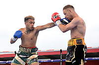 Lee Hallett (red gloves) defeats Harley Benn during at Boxing Show at Stevenage Football Club on 18th May 2019